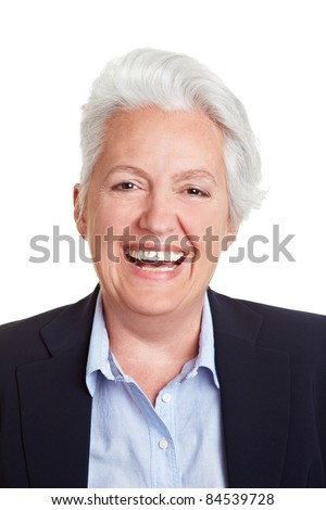 Frontal head shot of a happy smiling senior woman - stock photo