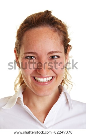 Frontal portrait of a smiling young business woman - stock photo