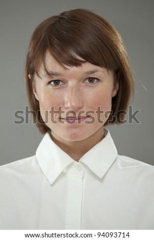 Frontal portrait of a woman over grey background - stock photo