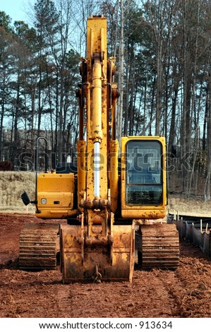 Frontal view of a backhoe - stock photo