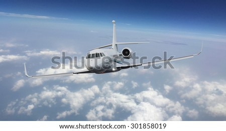 Frontal view of a private jet flying  - stock photo