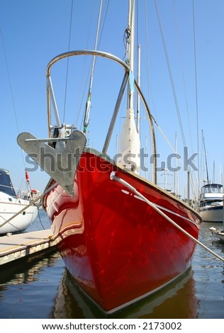 Frontal view of a red sailboat. - stock photo