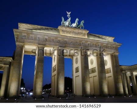 Frontal view of Brandenburg Gate at dusk in a beautiful summer day, Berlin, Germany, Europe.