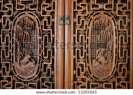 frontal view of door with wood carvings - stock photo