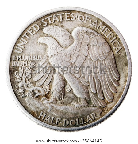 Frontal view of the reverse (tails) side of a silver half Dollar minted in 1942. Depicted is a bald eagle rising from a mountaintop perch. Isolated on white background. - stock photo