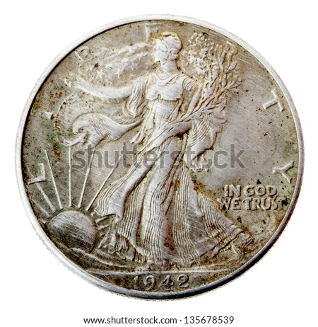Frontal view of the reverse (tails) side of a silver half Dollar minted in 1942. Lady Liberty walking and holding branches and the United States flag over her shoulder. Isolated on white background. - stock photo