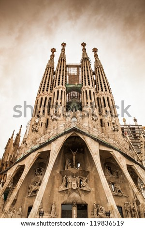 "Frontal view of this architecture masterpiece, ""La Sagrada Familia"" by Antoni Gaudi. Picture without cranes, cleaned digitally. Barcelona. - stock photo"