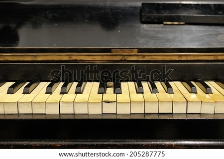 Frontal view of yellowed ivory piano keys - useful image for cleaning/restoration themes - stock photo