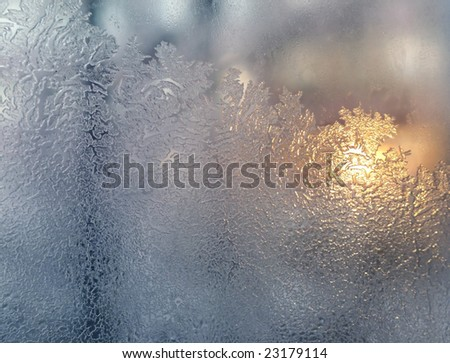 Frost and sun on glass - stock photo