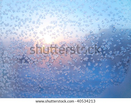 frost and sun on winter glass - stock photo