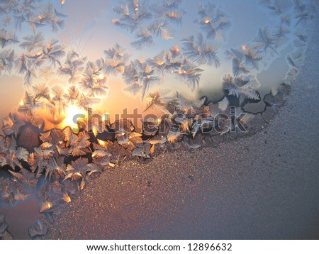 Frost and sun on winter window - stock photo