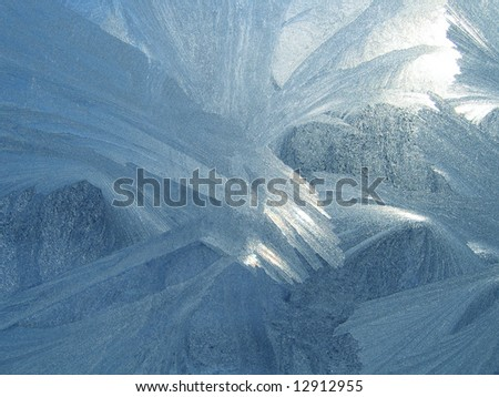 Frost and sun on winter window  background - stock photo