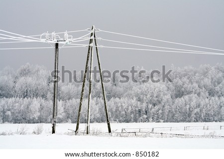 Frost crystals on Power Lines - stock photo