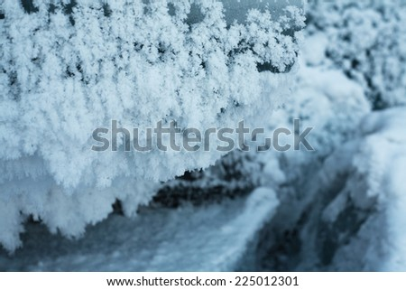 Frost is on the surface of ice - stock photo