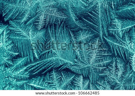 frost painting on the glass. frozen window. - stock photo