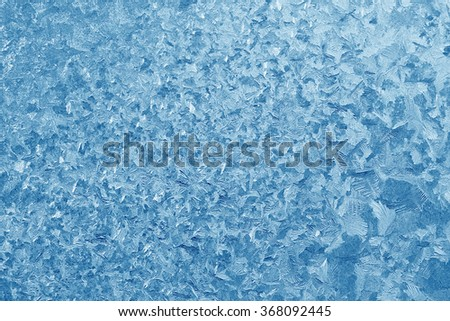 Frost patterns on window glass in winter. Frosted Glass Texture. Blue - stock photo