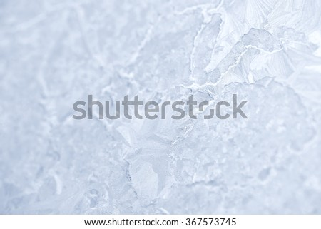 Frost patterns on window glass in winter. Frosted Glass Texture. White - stock photo