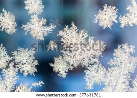 Frost snowflakes on winter window, ice background - stock photo