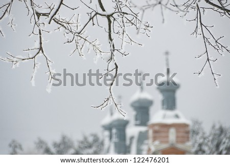 Frosted branches with Russian orthodox church on the background. - stock photo