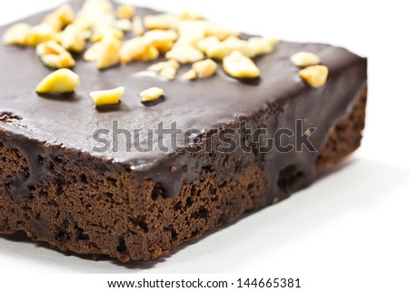 Frosted chocolate brownie on white background . Macro with  extremely shallow dof. - stock photo