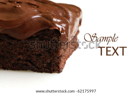 Frosted chocolate brownie on white background with copy space.  Macro with extremely shallow dof. - stock photo