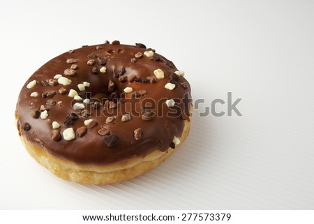 Frosted chocolate donut on a white background