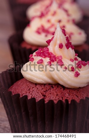 Frosted red velvet cupcakes, closeup. - stock photo