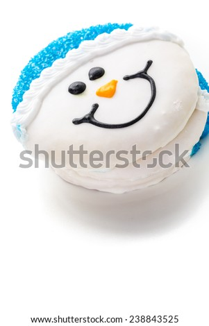 Frosted white sugar cookies in shape of snowman. - stock photo