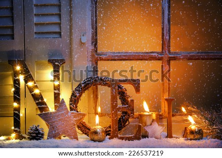 Frosted window with Christmas decoration - stock photo