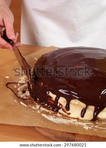 Frosting and icing layers. Making Chocolate Layer Cake with Cream Cheese Filling and Chocolate Topping. Series. - stock photo