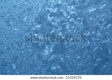 frostwork on the glass - stock photo