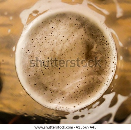 Frosty beer head one sip down top down view - stock photo