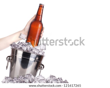 frosty beer with ice bucket and hand isolated on a white background