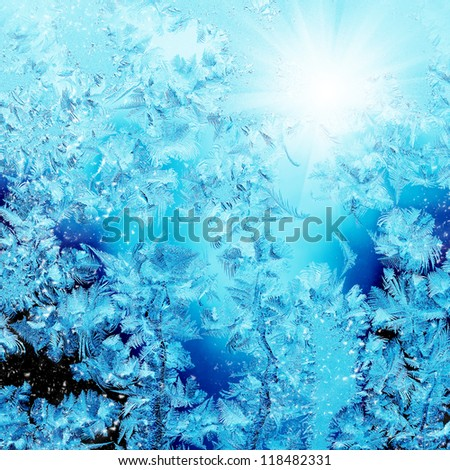 Frosty christmas pattern at a winter window glass - stock photo