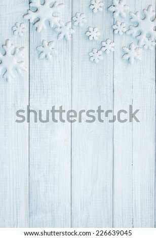 Frosty 3D Snowflakes on Rustic Wood Board Background with empty room or space for copy, text, your words.  Vertical blue tone white or gray - stock photo