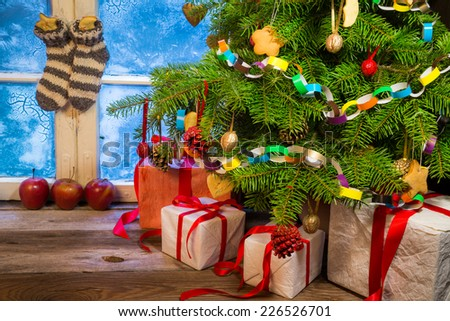 Frosty evening in a warm cottage in Christmas - stock photo