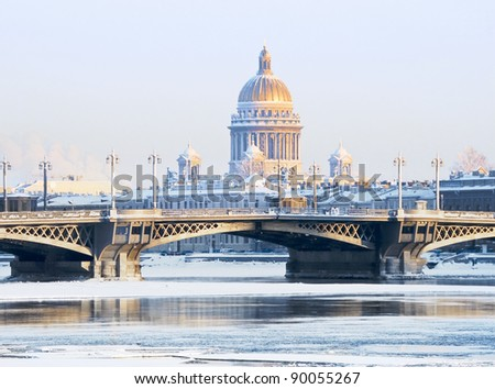 Frosty evening in St. Petersburg, Russia. Blagoveshchensky bridge and St. Isaac's Cathedral - stock photo