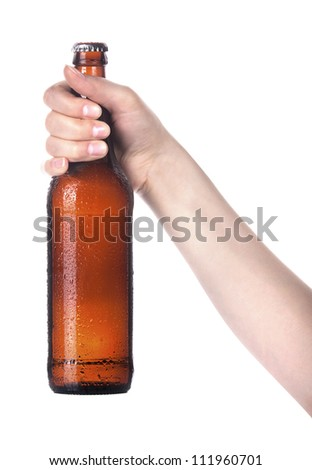 Frosty fresh bottle of beer in a hand isolated. making toast on a white background