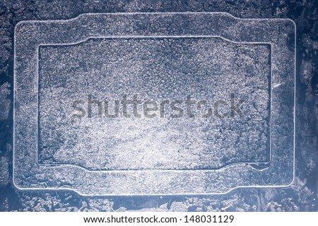 Frosty glass frame with ice pattern. - stock photo