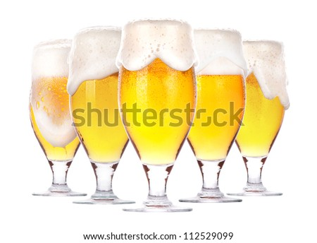 Frosty glass of beer with foam isolated on a white background - stock photo