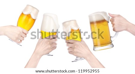Frosty glass of beer with hand.making toast - stock photo
