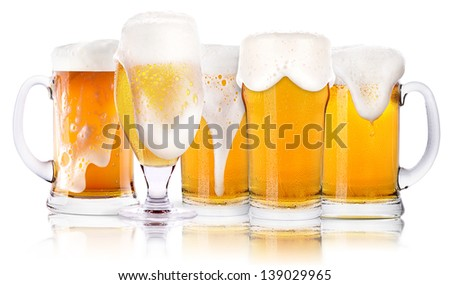 Frosty glass of light beer set isolated on a white background