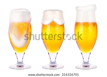 Frosty glasses of light beer isolated on a white background