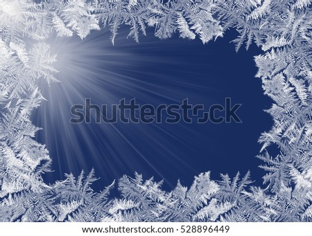 frosty ice border pattern on dark blue with light rays