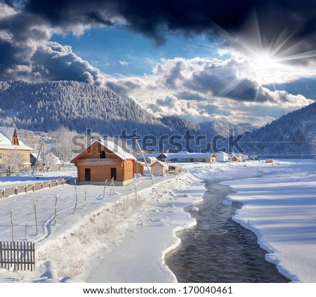 Frosty morning in the mountain village. - stock photo