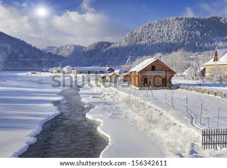 Frosty morning in the mountain village. Iltsi village, Carpathian, Ukraine, Europe. - stock photo