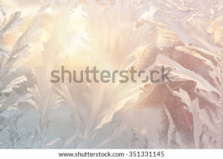 Frosty natural pattern and light of sun on winter window - stock photo