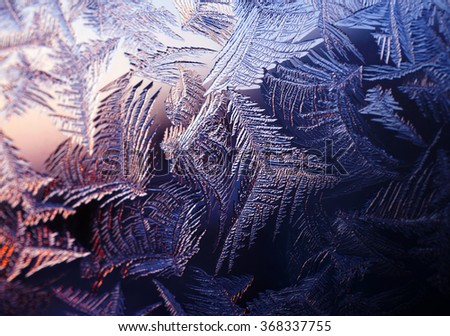 Frosty natural pattern at a winter window  - stock photo