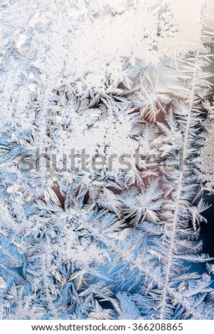 frosty natural pattern on winter window glass - stock photo
