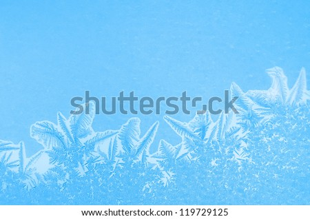 Frosty pattern at a window. - stock photo